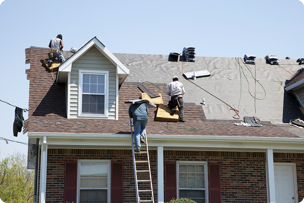 Roofing contractor working on homeowners roof.